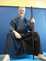 Me, dojo, on physio-ball with sword.