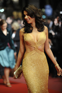 Mallika Sherawat stunning hot stills,Sexy Mallika Sherawat photos  in yellow