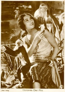 What's up with the preponderance of pinups featuring actresses with monkeys? Dolores del Rio.