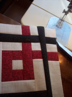 Black, White and Red Fabric made into a Quilt Block