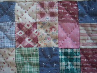 Quilt in Pink made of Squares