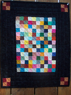 Little quilt in Amish Colors made with Squares