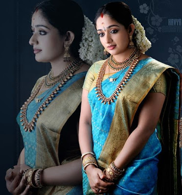 South Indian actress Kavya Madhavan in beautiful blue colour wedding saree