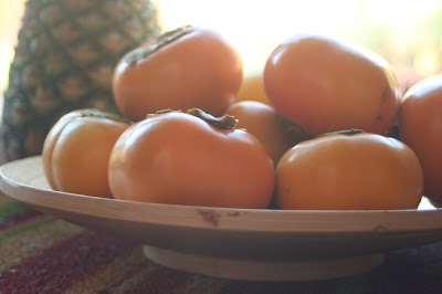 Fuyu persimmons, in varying states of ripeness