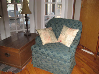 green upholstered rocking chair