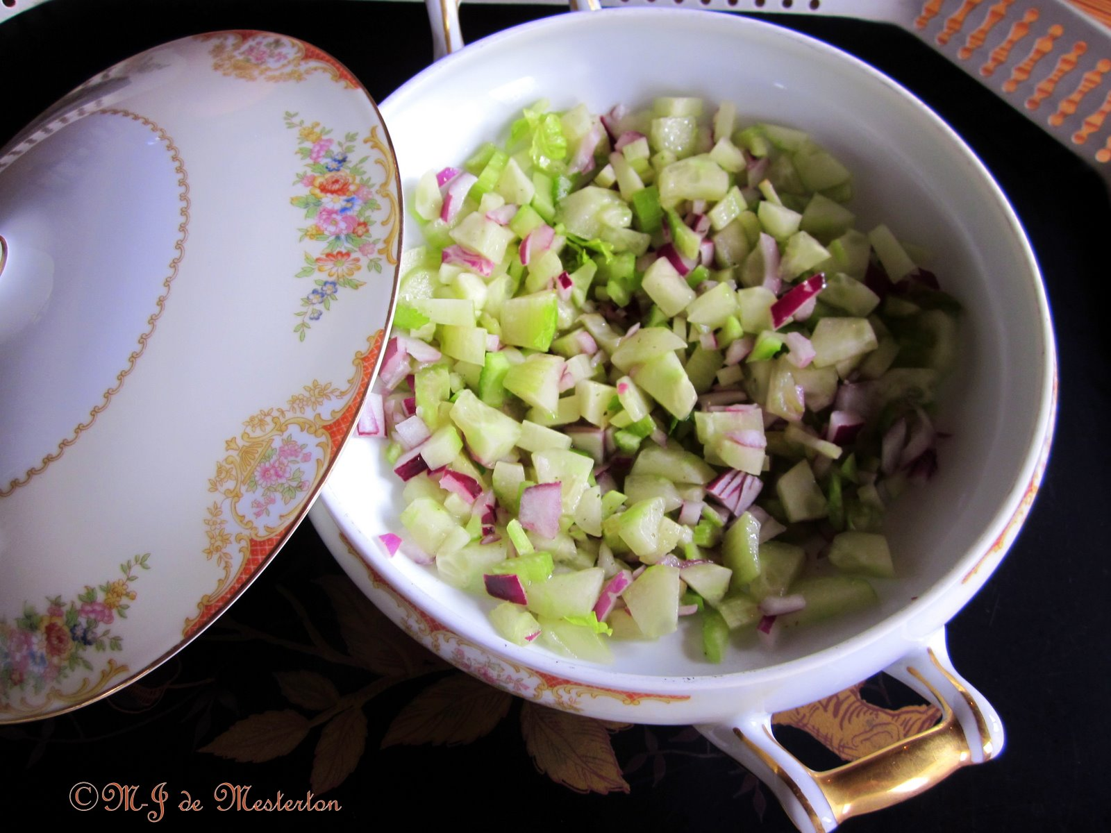 Celery, cucumber, and red onion are chopped into small bits and tossed