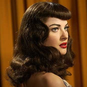 I learned how to do Bettie Page bangs: