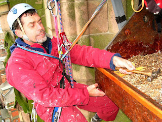 Nick evans fits a grip strip to the front of the peregrine nest platform