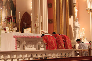 At the Confiteor during the Prayers at the Foot of the Altar.