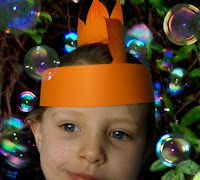 Cyan wears orange Stegosaurus dinosaur party hat