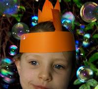 Cyan wears orange Stegosaurus dinosaur party hat