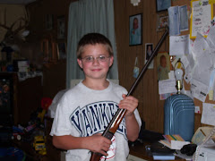 Kyle and his new gun for his 12th birthday