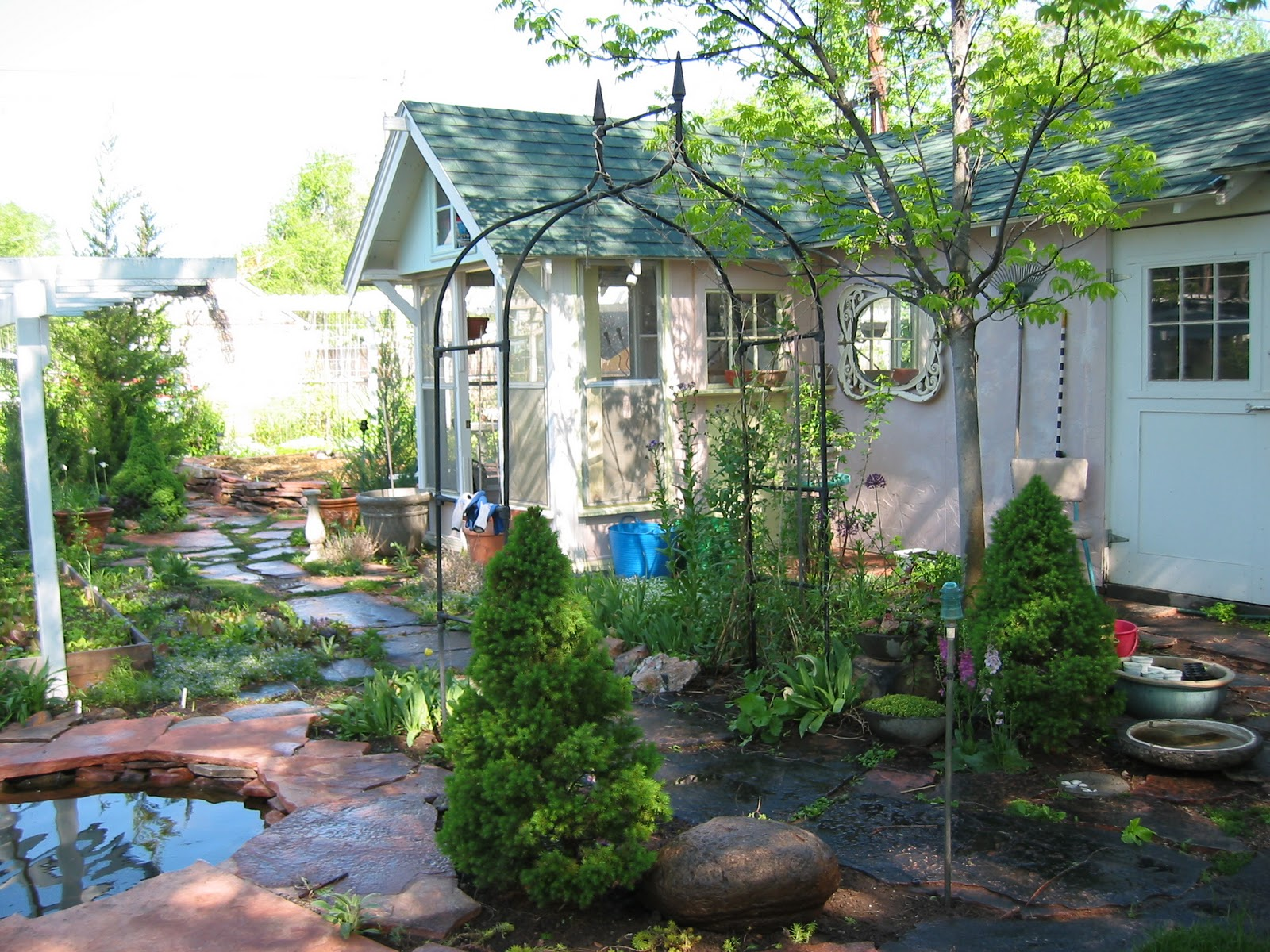 Little garden house - My Pathways Are Made From The Local Pink Limestone So I Painted The Walls Pinkish Notice The Mirrow We Salvaged The Wooden Tower In The Front Of The