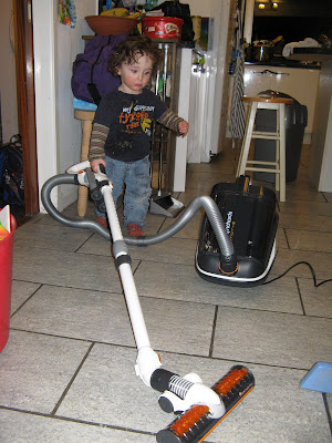 toddler with hoover