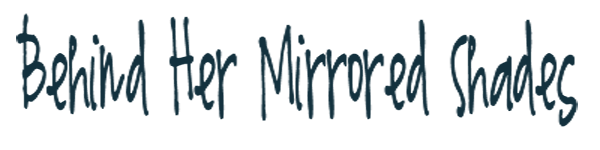 Behind Her Mirrored Shades...
