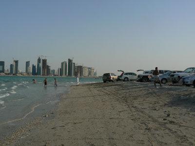 Land cruisers drawn up on a Doha beach