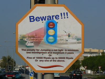 Qatari Road Sign: warning against jumping red lights