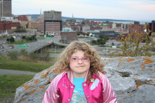 Kennedy - the Super Grammar girl, high above her beloved city of Saint John