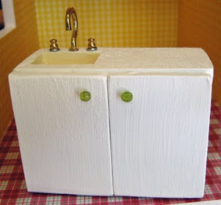 Dollhouse Kitchen Sink Dollhouse decorating making your own homemade dollhouse kitchen for another example of this miniature kitchen sink and cupboard see this picture in a later post it uses little snippets of thin dowels to create faucet workwithnaturefo