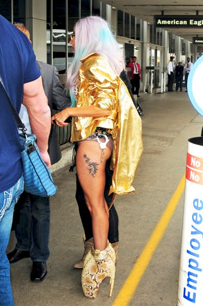 This is Lady Gaga and her new tattoo which apparently is the title of her
