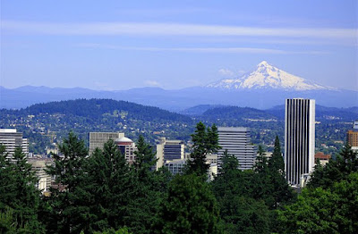 Photo of the Portland skyline, trees, and Mt. Hood