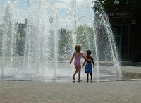 Photo of kids playing in a fountain