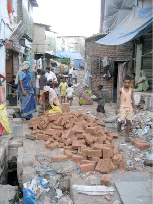 Photo of people working with bricks in Dharavi