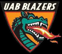 Black background behind a zoomed in view of a green fire spitting dragon in a golden triangle labeled UAB Blazers.
