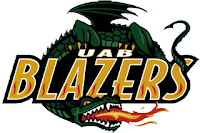 Long tailed, long necked, and winged green dragon spitting fire while wrapping its body around the words UAB Blazers.