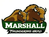 Two drawn brown buffaloes standing over a the word Marshall in white text over a green banner with the words Thundering Herd in white text on a black background below both the buffaloes and Marshall text.