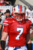 SMU football player in red uniform.