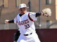 New Mexico State baseball player pitches.