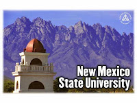 New Mexico State University postcard with mountain background.