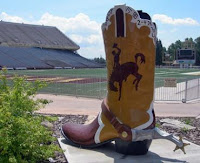 University of Wyoming boot next to college football field.