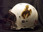 White Wyoming football helmet with brown cowboy logo.