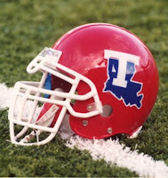 Red Louisiana Tech football helmet on field.
