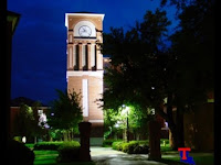 Louisiana Tech lit clock tower at night.