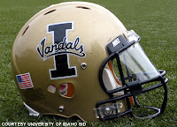 Idaho Vandals gold football helmet on the grass.