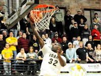 Idaho basketball player slam dunks.