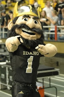 Vandals mascot in football uniform at college football game.