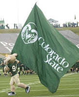 Colorado State flag carried by mascot on football field.