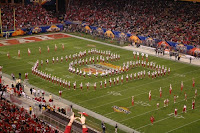 Utah band makes a U shaped formation on the football field.
