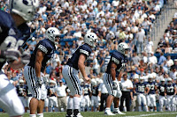 BYU football team in blue uniforms lines up for a kickoff during a game.