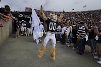 BYU Cougar mascot runs out at a football game.