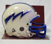 White Air Force football helmet with blue lighting bolt and blue face mask.