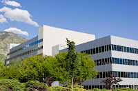 Large white academic building on BYU campus.
