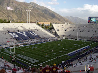 BYU football stadium with mountain background.