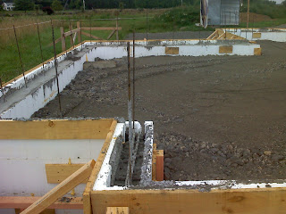 Foundation poured and centre being filled with river run