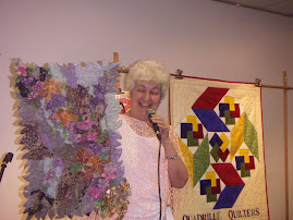 Quadrille Quilters New banner in Background