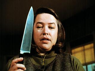 Kathy Bates holding a knife